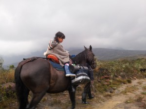 Nicole riding to cover the long distances during shooting (Photo Ángela Aguirre)